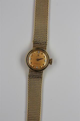 Omega: An 18ct gold lady's Ladymatic quartz wristwatch