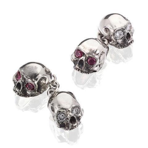 A pair of gem-set skull cufflinks