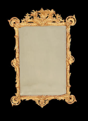 A late 19th century gilt composition mirror in the Rococo style