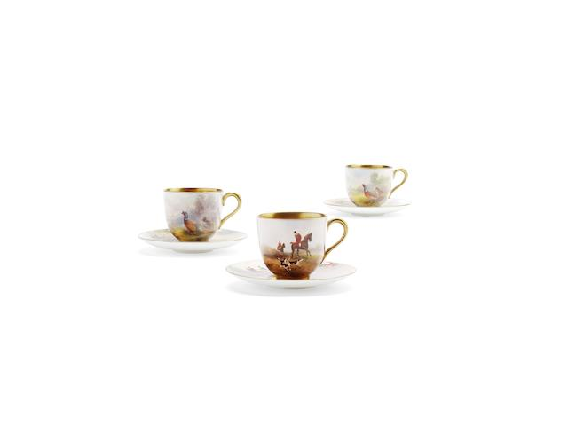 Three Royal Worcester coffee cups and saucers