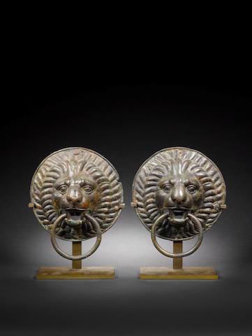 A pair of Roman bronze lion head handles