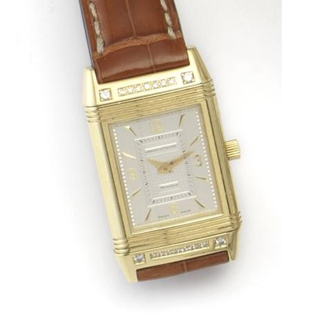 Jaeger-LeCoultre. A lady's 18ct gold and diamond set manual wind wristwatch Reverso, Ref.260.1.86, Case No.1808911