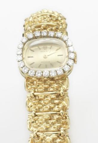 Rolex. A lady's 18ct gold and diamond set manual wind bracelet watchCirca 1980
