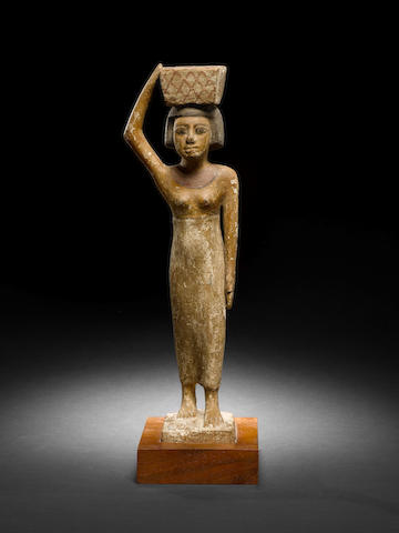 An Egyptian wood figure of a servant with original letter