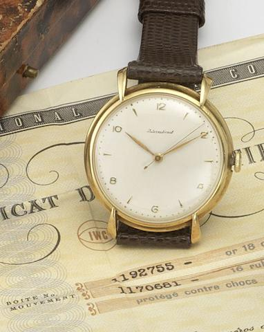 IWC. An 18ct gold manual wind wristwatch together with original guarantee certificate Case No. 1192755, Movement No. 1170681, 1950's