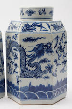 A pair of Chinese blue and white Export ware hexagonal jars and covers, Qing dynasty, 19th Century, painted with dragons chasing flaming pearls, 28cm.