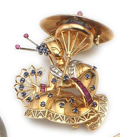 Rolex. An 18ct gold, diamond, sapphire and ruby set watch brooch in the form of a Geisha girl1950's