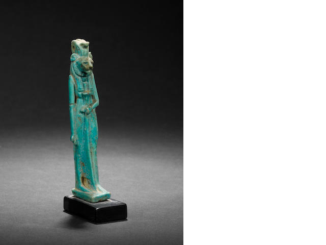An Egyptian turquoise glazed composition amulet of Sekhmet