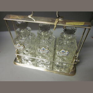 An electroplated three bottle tantalus,