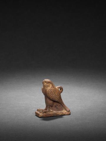 An Egyptian quartz/granite falcon