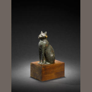 An Egyptian bronze cat with original catalogue note