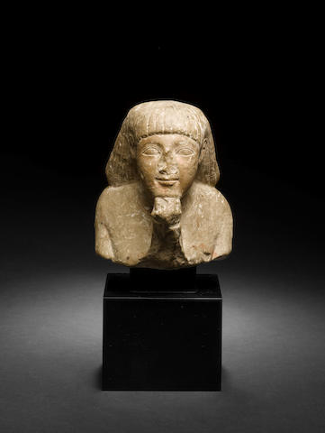 An Egyptian stone head with original receipt