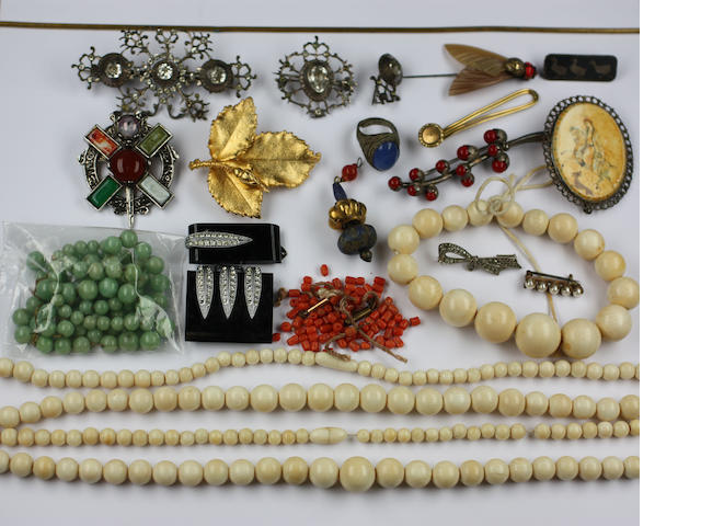 Two ropes of ivory beads, graduated from the centre, a similar bracelet, a rope of jade? beads graduated from the centre, three brooches set with white and coloured paste and various costume jewellery.