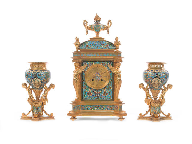 A good late 19th century French champleve enamel and gilt brass clock garniture