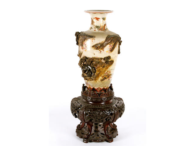 A Japanese Satsuma pottery vase and hardwood stand, Meiji period