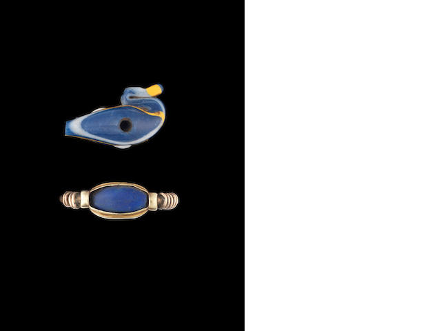 An Egyptian glass duck amulet and a Lapis and gold ring 2