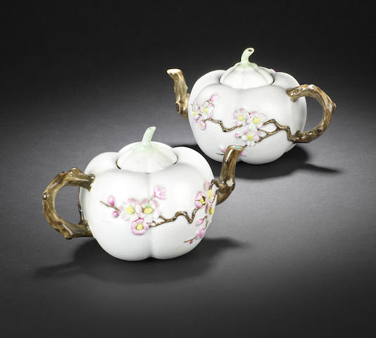 A rare pair of famille rose 'melon' teapots and covers Iron-red Qianlong seal marks, Late Qing Dynasty/ Republic