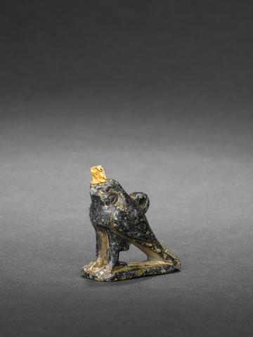 An Egyptian diorite falcon amulet