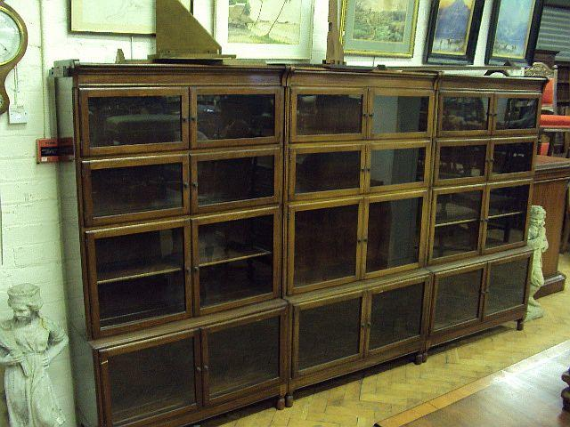 A set of three mahogany bookcases, early 20th Century, by Minty Each bearing ivorine 'Minty' label