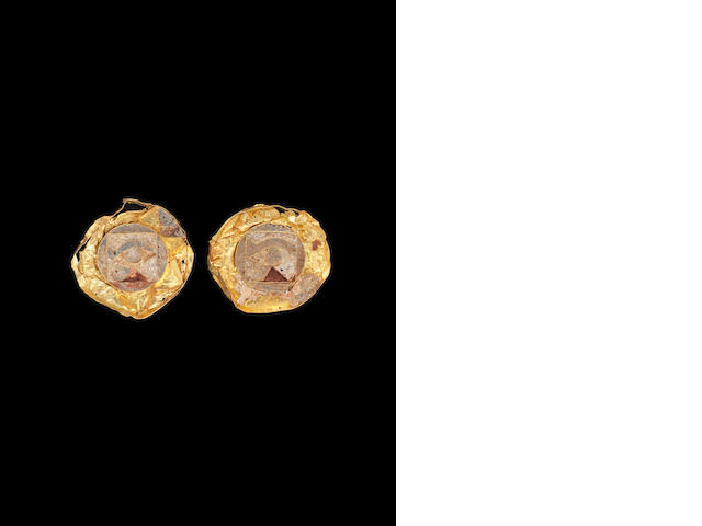 Two Egyptian gold and enamel eye inlays  2