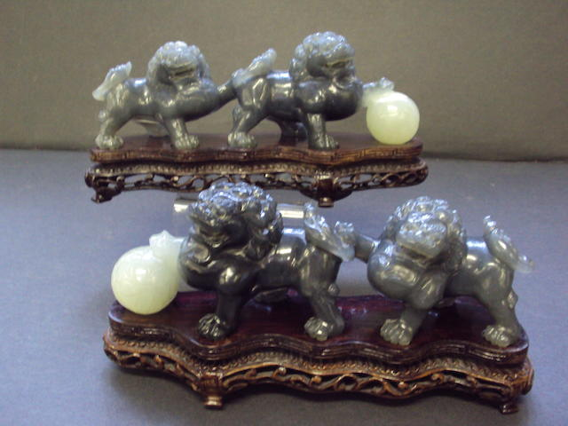 Two modern jade figures of lion dogs