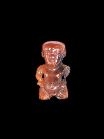 An Egyptian carnelian figure of a janiform Ptaichos