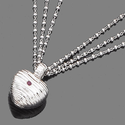 A ruby and diamond-set pendant necklace, bangle and earclip suite, by Roberto Coin (3)