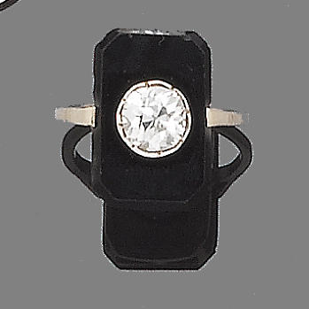 An Art Deco onyx and diamond dress ring,