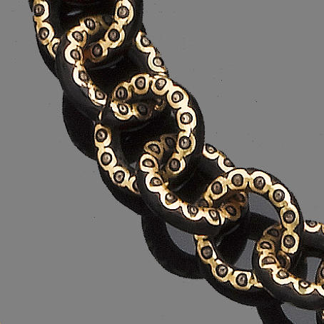 A gold and tortoiseshell pique posé longchain,
