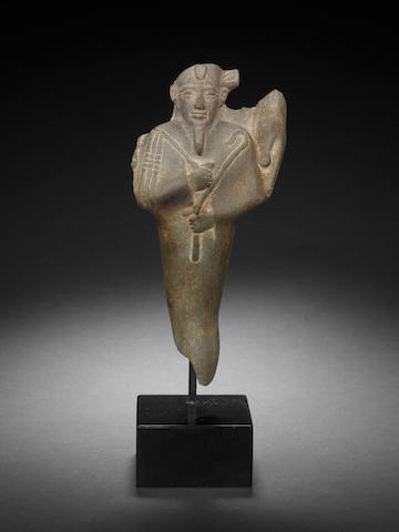 An Egyptian schist greywacke figure of Osiris