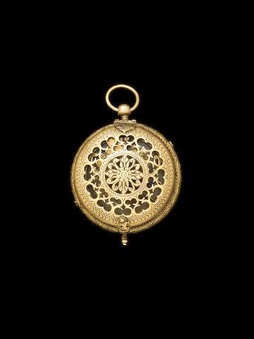 A Persian brass qibla
