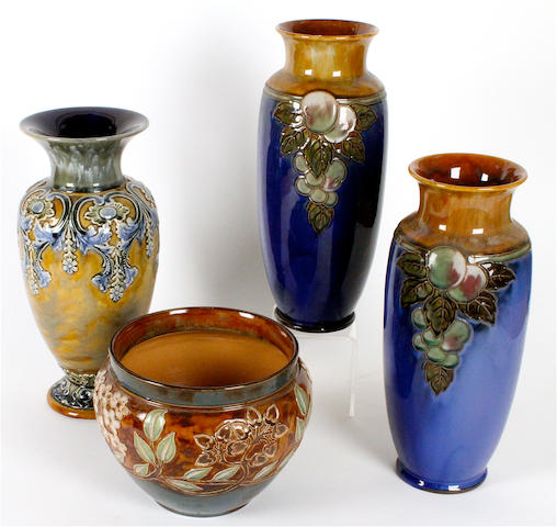 A large pair of Royal Doulton stoneware vases, another and a jardiniere