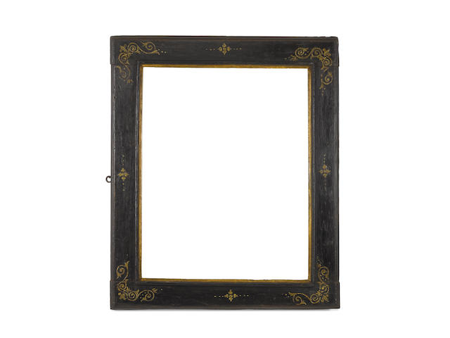 An Italian late 16th Century carved, ebonised and parcel gilt cassetta frame