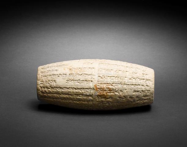 A Mesopotamian terracotta cuneiform cylinder