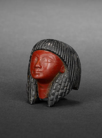 An Egyptian glass and steatite male head