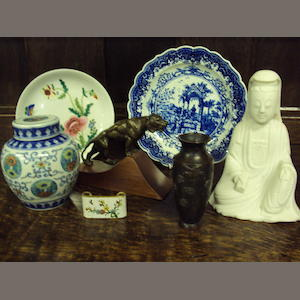 A mixed collection of ceramics and works of art