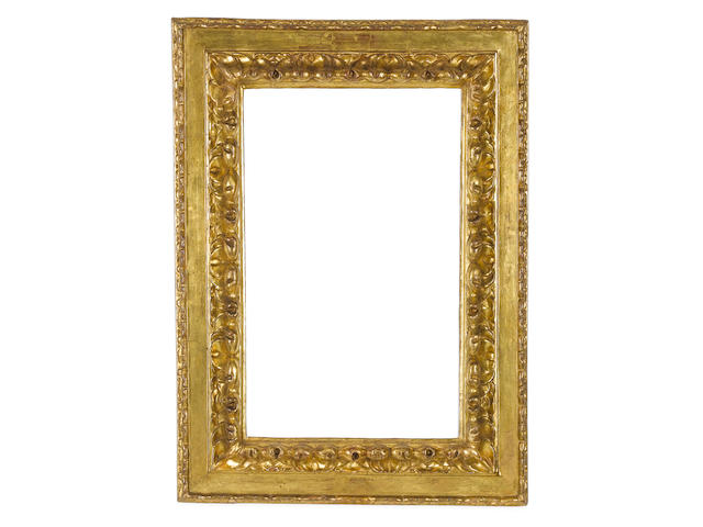 An Italian early 17th Century carved and gilded cassetta frame