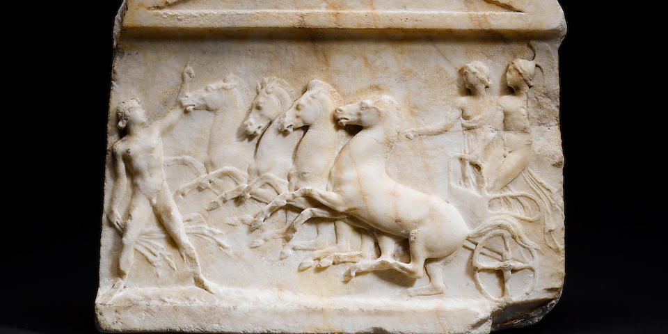 A Roman marble relief panel