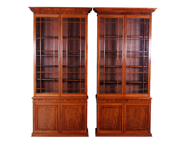A pair of William IV mahogany library bookcase cabinets