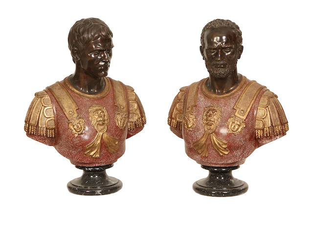 A pair of bronze and polychrome busts of Roman Emperors