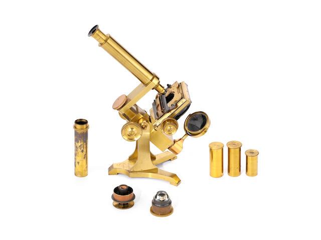 A Moritz Pillischer brass compound monocular microscope