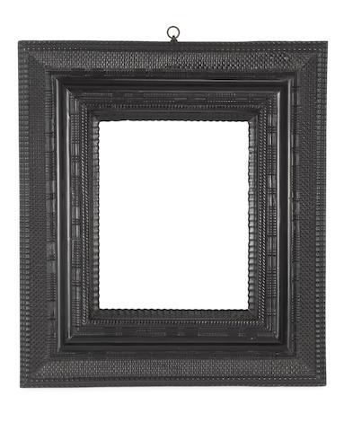 A Dutch 17th Century ebonised ripple moulding frame