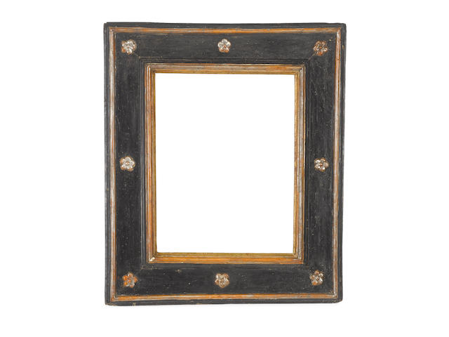 An Italian late 16th Century ebonised, silvered and parcel gilt cassetta frame