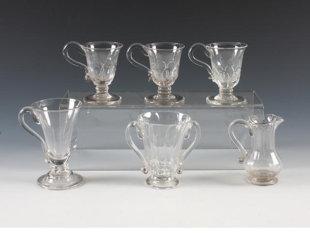 A set of three handled jelly glasses, two other jelly glasses and a jug Circa 1750.