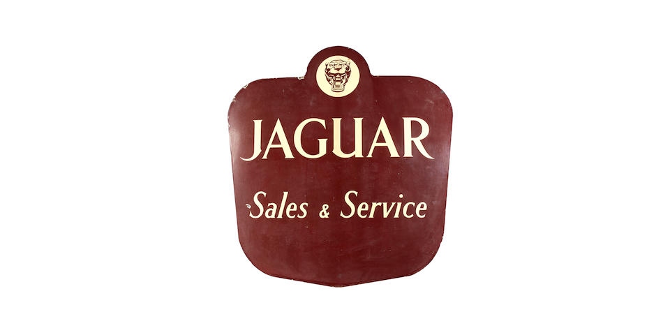 A rare Jaguar Sales & Service shaped enamel sign,
