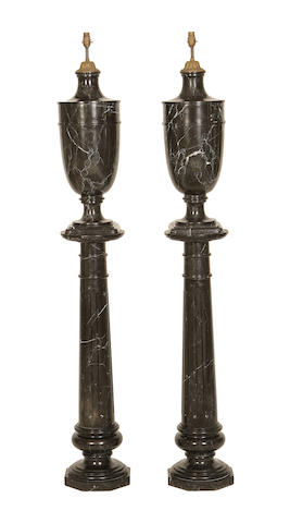 A large pair of Nero Marquina marble lamps on columns