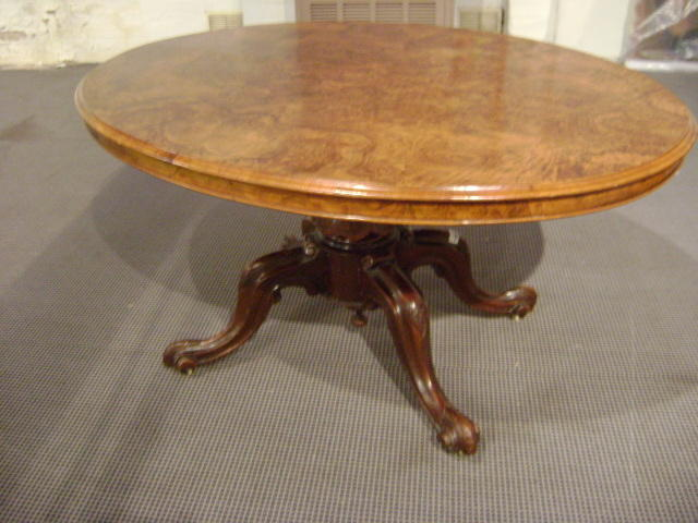A Victorian walnut loo table