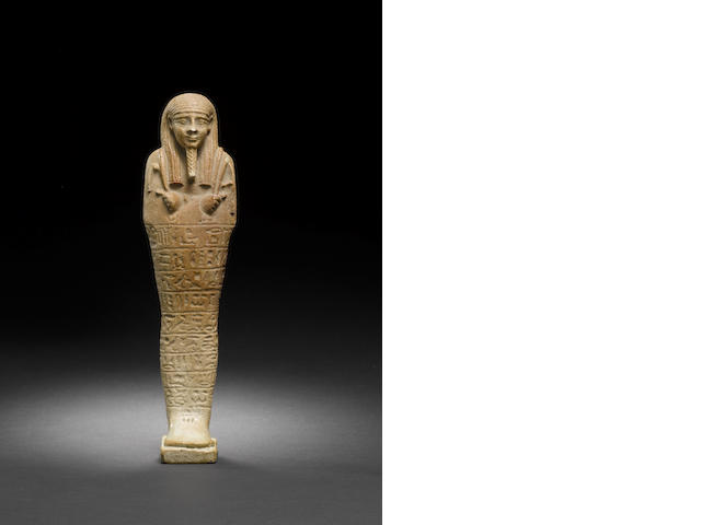 An Egyptian brown glazed composition shabti