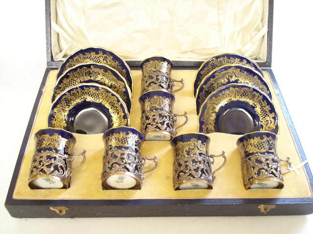 A silver mounted Coalport cased coffee set