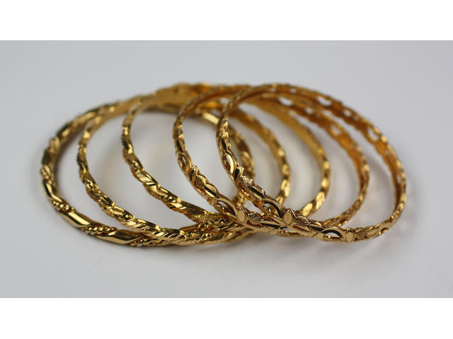 Five precious yellow metal bangles